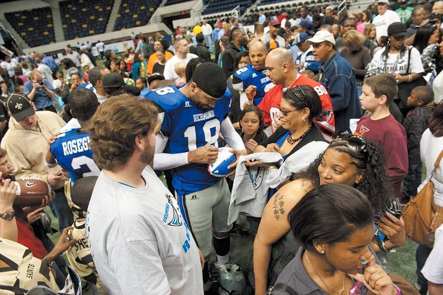 Aaron Alexander, the backup quarterback who replaced Randall late in the Raiders season opener, signs autographs after the game. - SCOTT ELMQUIST