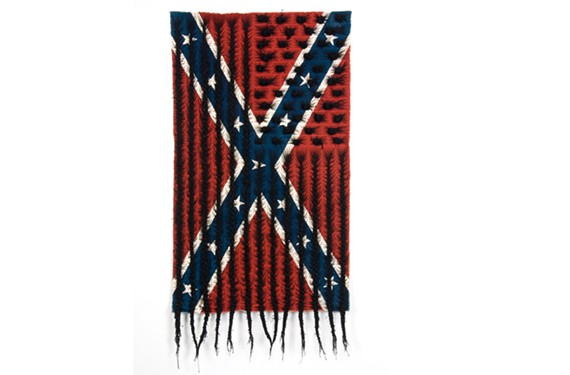 """Acclaimed local artist Sonya Clark's """"Black Hair Flag"""" is one of the provocative pieces in """"Fusion: Art of the 21st Century"""" at the Virginia Museum of Fine Arts. The show was curated by the museum's John Ravenal, who is leaving to become executive director of the deCordova Sculpture Park and Museum in Massachusetts."""