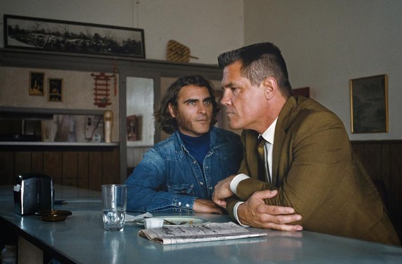 "Actor Joaquin Phoenix plays stoned private eye Doc Sportello to Josh Brolin's hardboiled police lieutenant, Bigfoot Bjornsen, in a meandering but fun adaptation of the 2009 novel ""Inherent Vice"" by writer Thomas Pynchon. The story is set in Los Angeles of 1970 during the wake of the Charles Manson arrests and the death of the hippie movement."