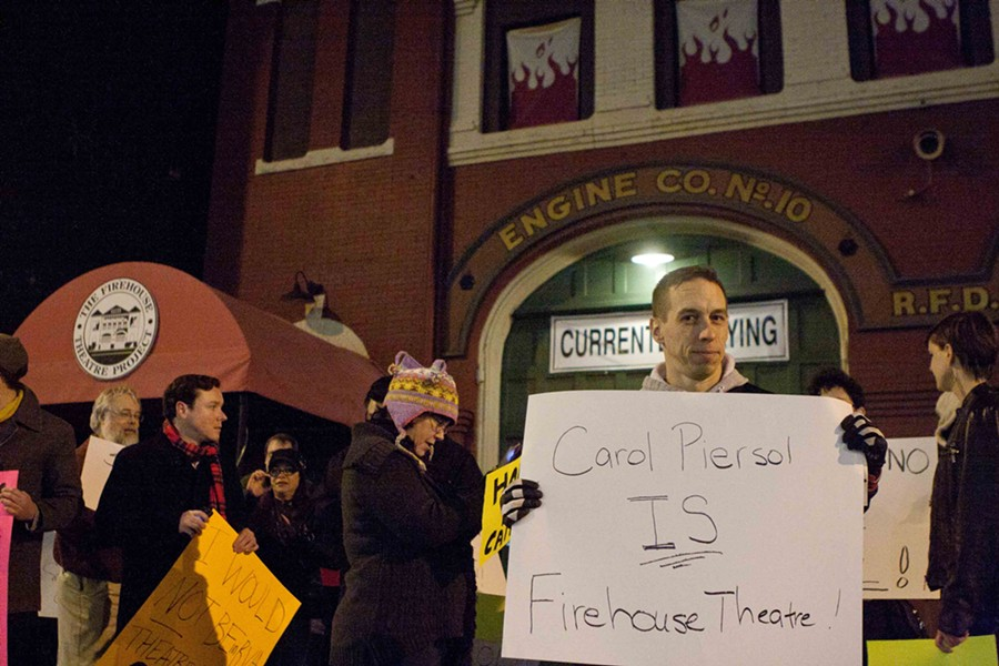 Actor Scott Wichmann and more than a dozen people protested Carol Piersol's ouster Tuesday evening in front of the Firehouse Theatre. - BY NED OLIVER