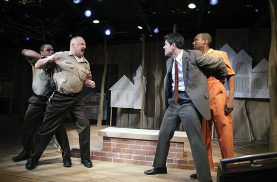 "Actors Jeremy Howard, David Bridgewater, Adrian Rieder and Ronnie Brown throw down in Virginia Rep's ""Scorched Earth,"" a production of David Robbins' novel. - JAY PAUL"