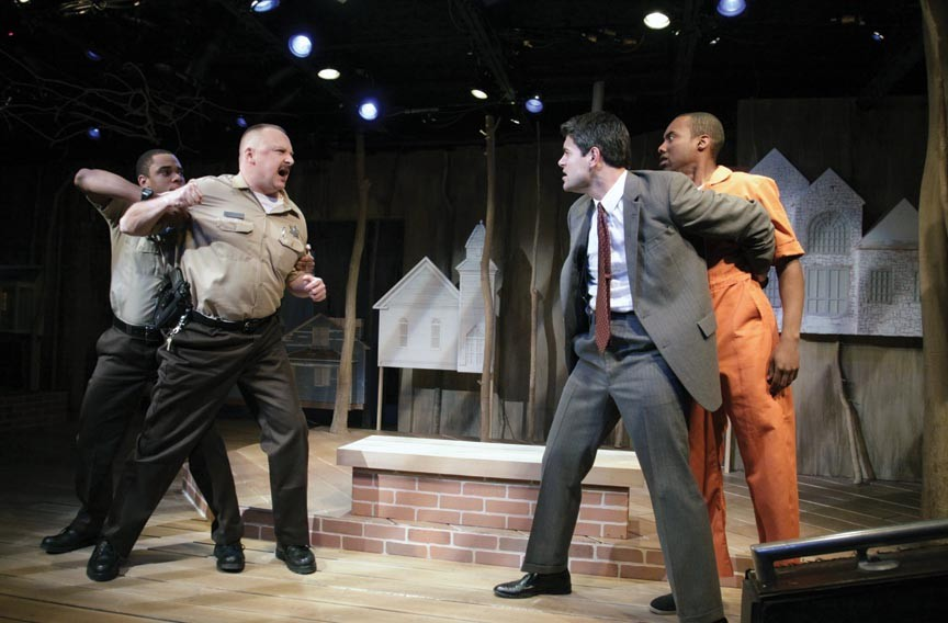 """Actors Jeremy Howard, David Bridgewater, Adrian Rieder and Ronnie Brown throw down in Virginia Rep's """"Scorched Earth,"""" a production of David Robbins' novel. - JAY PAUL"""