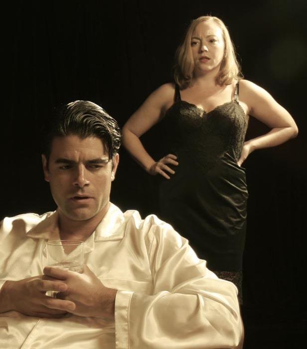 """Adrian Rieder and Laine Satterfield in Firehouse's """"Cat on a Hot Tin Roof."""""""