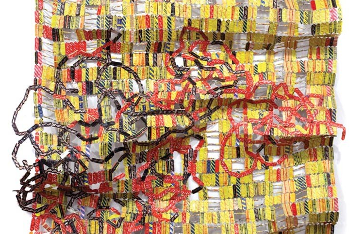 """Africa talks to you: El Anatsui's """"Bukpa Old Town"""" uses aluminum and copper wire to depict the dark side of progress."""