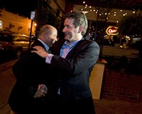 After eking out an apparent victory, Jon Baliles greets a well-wisher outside of Caliente.