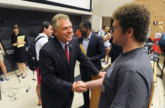 After explaining the key planks of his gubernatorial campaign last week, McAuliffe greets students of Larry Sabato's introduction to American politics class. - SCOTT ELMQUIST
