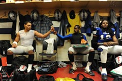 After the team's first victory against the Trenton Steel, Rodney Landers and Junior Rosegreen celebrate over pizza in the locker room. - SCOTT ELMQUIST