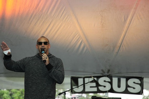 Aguilar preaches in 2010 during a tent revival outside his church's previous location on Warwick Road. - CHRISTINE LOCKERBY
