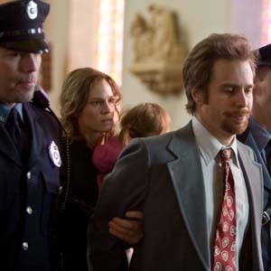 """""""Another criminal with a bad goatee brought to justice."""" Hilary Swank is Betty Anne and Sam Rockwell is her brother Kenny in the far-from-appealing """"Conviction."""" Photo by Ron Batzdorff"""