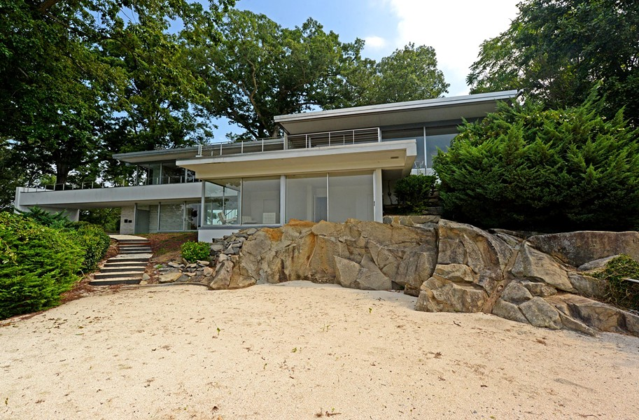 Architecture and nature merge at the landmark house commissioned 50 years ago by Inger and Walter Rice for Dead Man's Hill near Windsor Farms. - SCOTT ELMQUIST