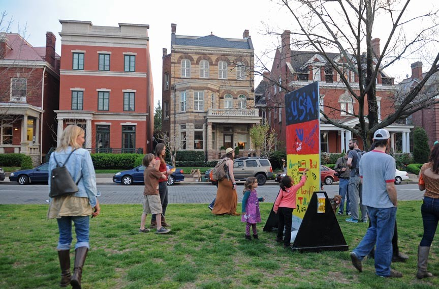 Around 400 people walked down Monument Avenue on April 3 to show their support for the Art 180 installation. The paintings were taken off the median Monday. - SCOTT ELMQUIST