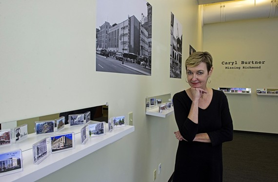 Artist Caryl Burtner stands amid her installation documenting the region's changing landscape at the University of Richmond downtown.