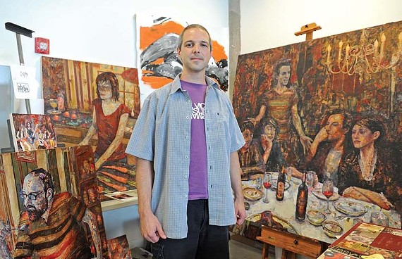 "Artist Josh George shows off recent work in his Rocketts Landing studio. His ""weird snapshots of domestic life"" will be shown at Ghostprint Gallery in September. - SCOTT ELMQUIST"