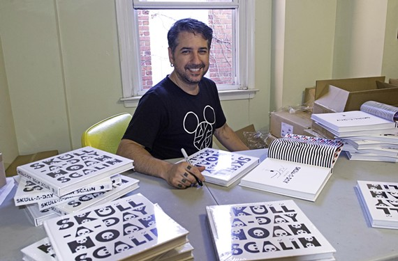 """Artist Noah Scalin signs copies of his new art book, """"Skull-A-Day,"""" which is the inaugural release from the Chop Suey Books Books imprint."""