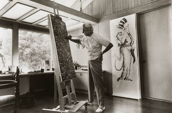 "Artist Theodor Seuss ""Ted"" Geisel, otherwise known as Dr. Seuss, works on a painting while arguably his greatest creation, the Cat in the Hat, looks on. You may not know it, but Geisel had a thing for eccentric hats, and his stash is coming to Midlothian."