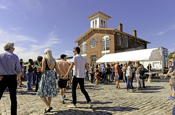 Arts, culture and theater have been a key to Petersburg's renaissance. Attendees enjoy the sixth annual Festival of Grapes and Hops in Old Towne Petersburg held over the weekend.