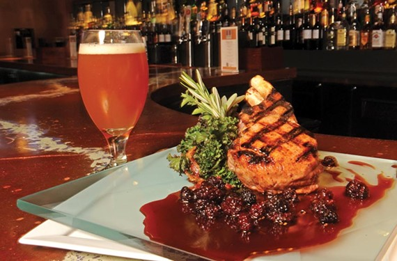At Accanto, the pork chop in blackberry sauce shows chef Ryan Baldwin's interest in contrasting flavors. - SCOTT ELMQUIST
