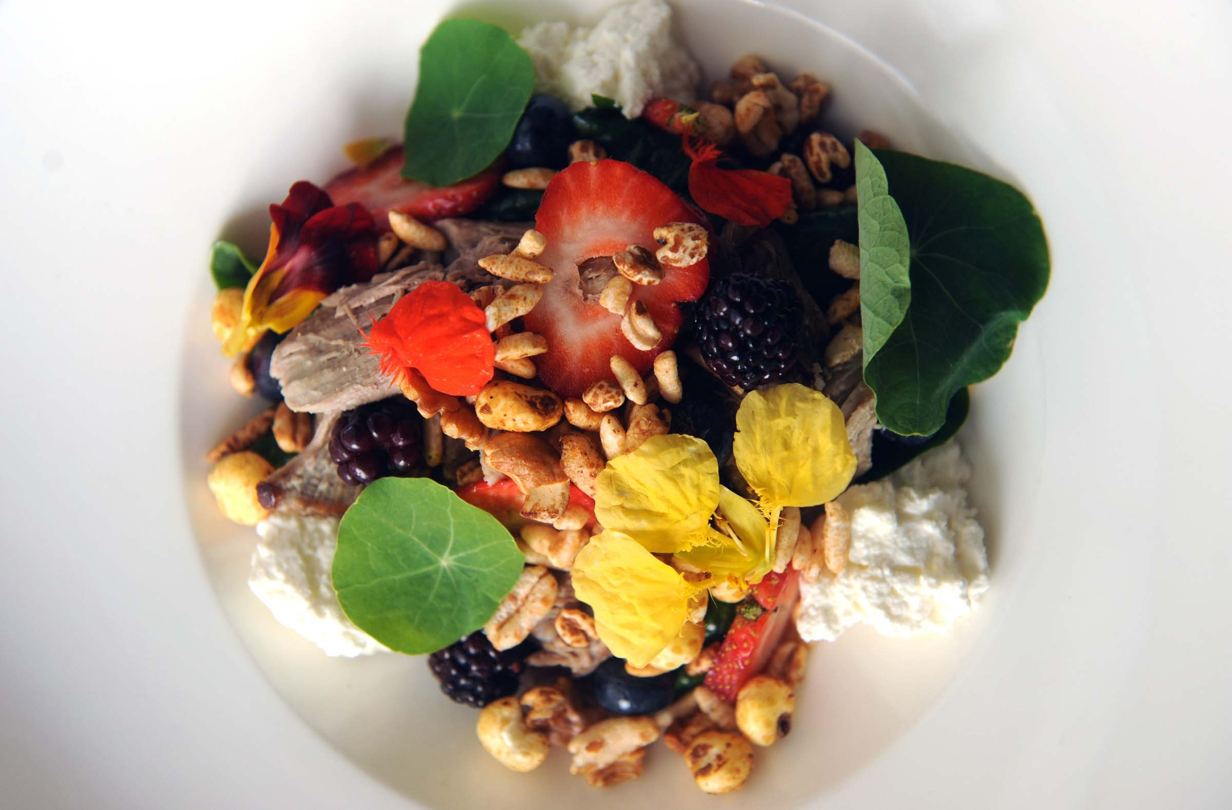 At Dutch & Co., milk-braised veal is surrounded by granola, pickled berries, spinach and ricotta in a composition that's delightfully nuanced. - SCOTT ELMQUIST