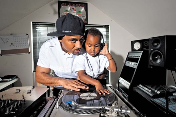 "At home, DJ Danja Mowf and his son Jordan do a little father-and-son beat matching. ""I was told to find something I love to do and get paid for it."" - SCOTT ELMQUIST"