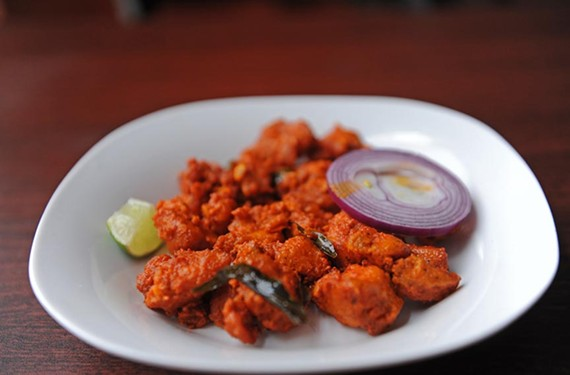 At Kebab & Biryani, the chicken 65 appetizer is boneless pieces marinated with Indian spices and deep fried, sautéed with yogurt and curry leaves, priced at $7.99. - SCOTT ELMQUIST