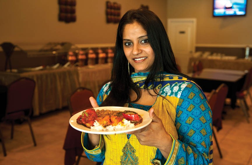 At Noorani Kabab House, owner Shagufta Sajid wears traditional Pakistani clothing; here she serves tandoori chicken, aloo palak, butter chicken, chana masala, hakka chili chicken and rice. Noorani uses only halal meats in its dishes. - SCOTT ELMQUIST