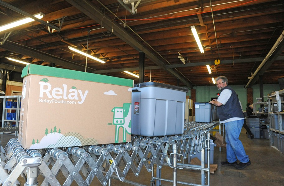 At Relay Food's processing center in Scott's Addition, customers' orders are collected and sorted into tubs that are trucked to one of a dozen distribution sites throughout the area. - SCOTT ELMQUIST