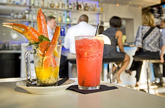 At Sample, steamed king crab legs are served in drawn butter, with a raspberry blonde cocktail. - ASH DANIEL