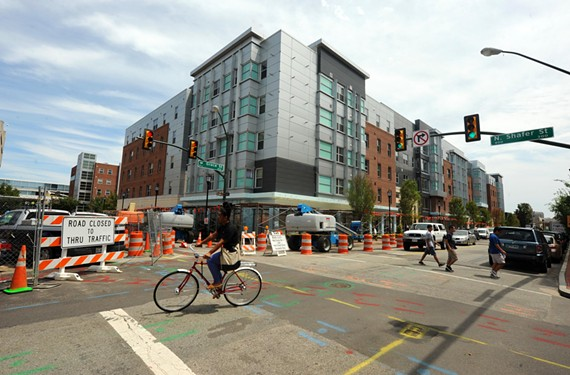 At Shafer and Grace streets, VCU's new West Grace Street North dorm offers a modern approach, but false windows, seen here, reach ridiculous proportions. - SCOTT ELMQUIST