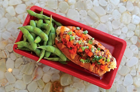 At the new downtown cafe A2, the tempura bento dog is topped with spicy mayo, scallions, eel sauce and masago, and served with edamame. - SCOTT ELMQUIST