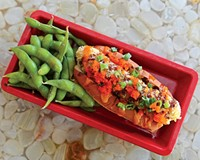 At the new downtown cafe A2, the tempura bento dog is topped with spicy mayo, scallions, eel sauce and masago, and served with edamame.