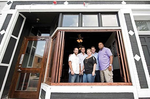 At the revamped Metro Grill in the Fan, Kevin Mandeville, Richie Masters, Jami Bohdan, Travis Bacile and Tony Hawkins show off the new front window and branding. - ASH DANIEL