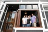 At the revamped Metro Grill in the Fan, Kevin Mandeville, Richie Masters, Jami Bohdan, Travis Bacile and Tony Hawkins show off the new front window and branding.