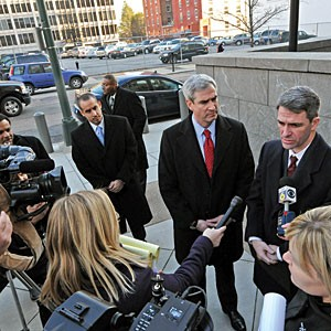 Attorney General Ken Cuccinelli talks to reporters outside U.S. District Court on Monday as U.S. Attorney Neil MacBride looks on.