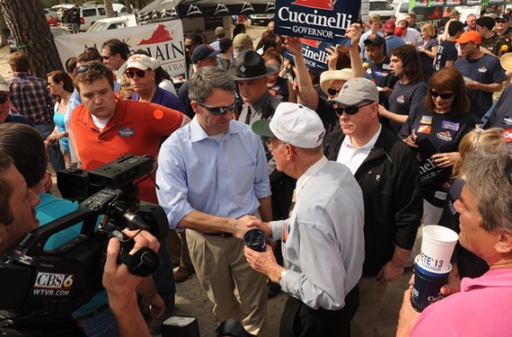 Attorney General Ken Cuccinelli, the Republican candidate for governor, presses the flesh at the Wakefield Shad Planking, a political rite in rural Virginia. - SCOTT ELMQUIST