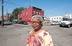 """Barbara Abernathy was raised in the neighborhood and returned in 1977. A longtime community activist, she wants a moratorium on student housing in Carver. """"I think the community needs to come together as a whole and plan for itself,"""" she says. - SCOTT ELMQUIST"""