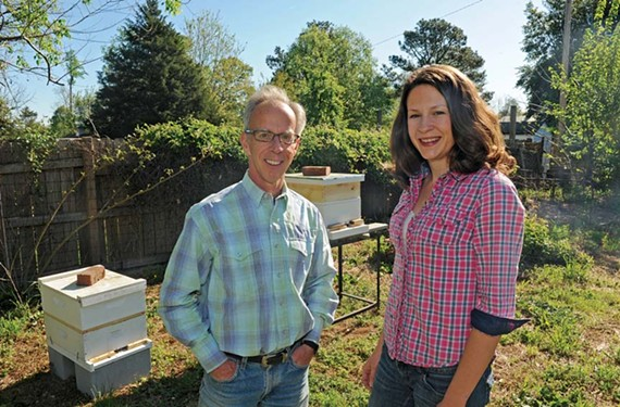 Beekeeper David Stover placed these hives in the backyard of a house in Westover Hills. He and organic gardener Nina Zinn hope to bring hives to Richmond's restaurants too. - SCOTT ELMQUIST