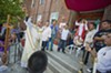 Before the procession begins, the Rev. Shay Auerbach asks God to bless the statue of San Miguel.