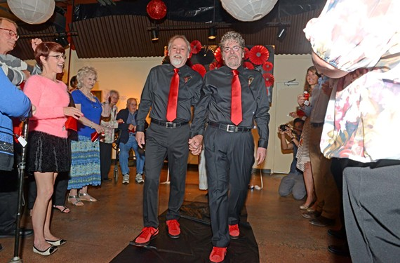 Ben Janosik and Ronnie Cash, a Richmond couple for 37 years, celebrate their wedding with a ceremony at Art Works studio and gallery as the Supreme Court begins weighing the constitutionality of same-sex marriage.