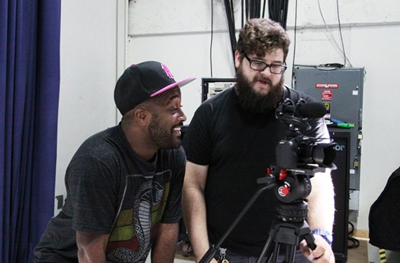 Beyonce choreographer Darrell Grand Moultrie, left, and local musician Dave Watkins discuss a video shot during a rehearsal for the Richmond Ballet's debut multimedia production.