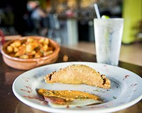 Beyond nachos: Try some bar food less ordinary, such as the homemade empanadas and patatas bravado at Emilio's Tapas Bar in the Fan.