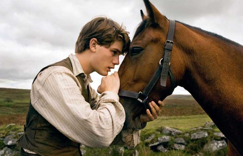 "Blazing saddles: Jeremy Irvine is Albert in the sentimental ""War Horse."" - ANDREW COOPER"