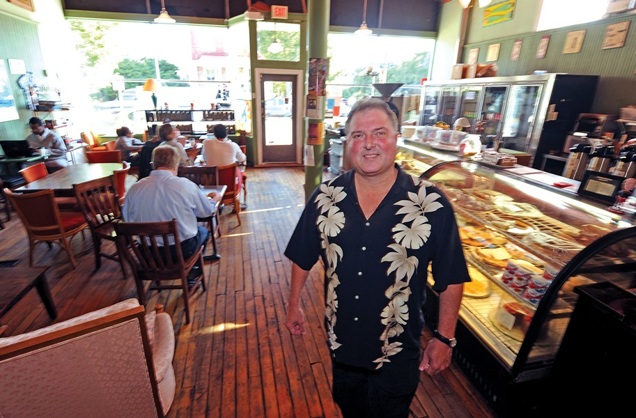 Bob Buffington stands in his Church Hill coffee shop, Captain Buzzy's Beanery. - SCOTT ELMQUIST