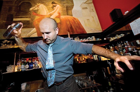Bobby Kruger, shown in action at Fanhouse before it closed, is tackling new bartending territory in New York. - ASH DANIEL