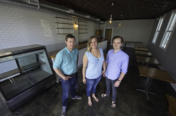 Brad Hemp, Brittanny Evans Anderson and Nathan Conway are putting finishing touches on Metzger Bar and Butchery, set to open in mid-June in Union Hill.