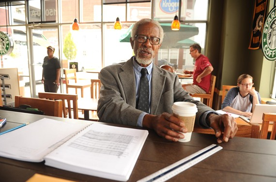 """Braxton reaches for the first of several cups of coffee while composing inside Starbucks. """"My musical legacy should be one of universal brotherhood,"""" he says. - SCOTT ELMQUIST"""