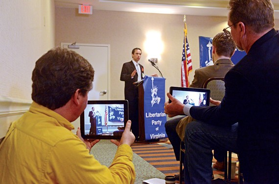 Bruce Majors, Libertarian candidate for Washington mayor, left, records former U.S. Senate candidate Robert Sarvis, who addresses the Libertarian Party of Virginia convention in Richmond on Feb. 8.