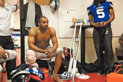 Bryan Randall in the locker room after tearing a knee ligament in the season opener. Losing Randall, the former Virginia Tech quarterback and a rising star in the arena game, significantly altered the Raiders season. - SCOTT ELMQUIST