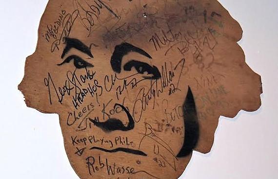 Buddy's giant George Washington image signed by celebrities.