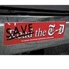 Bumper Sticker Upsets T-D Publisher