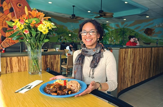 "Carena Ives shows oxtails at the new version of her south Richmond restaurant, which she says ""has the same vibe and island spirit, but with a patio and completely modern exterior."" - SCOTT ELMQUIST"